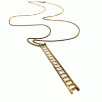 Complete your fab look with the Situated Ladder 13 Brass Necklace! Featuring brass casting gold color ladder decor, antique polished gold chain, finished with lobster hook closure.