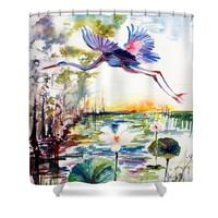 Blue Heron Glides over Lotus Flowers Shower Curtain by Ginette Callaway