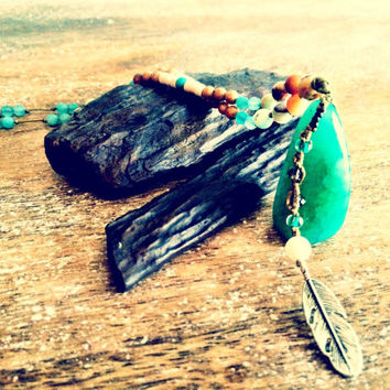 Native american inspired, Dragon Vein agate feather pendant.