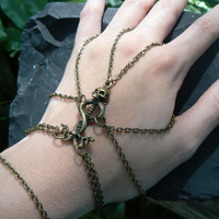 Gothic skull and serpent  slave bracelet spider hand chain rocker style