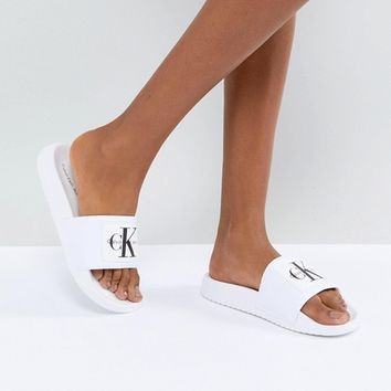 Calvin Klein Natural Pool Slides at asos.com
