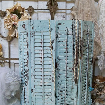 Wooden shutters pale blue and white heavily distressed recycled wall or table home decor Anita Spero