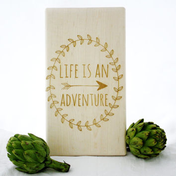 Engraved wooden cutting board. Life Is An Adventure. Arrow and wreath design. Custom kitchen decor by Milk & Honey.