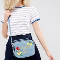 Skinnydip Slightly Bitter Denim Embroidered Cross Body Bag at asos.com