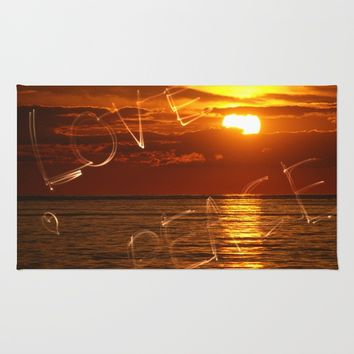 Love and peace sunset Rug by Claude Gariepy