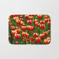 Red Tulips Bath Mat by Claude Gariepy