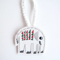 Christmas elephant ornament hand embroidered geometric shapes red and green on cream muslin with felt back and pom pom ribbon holiday gift