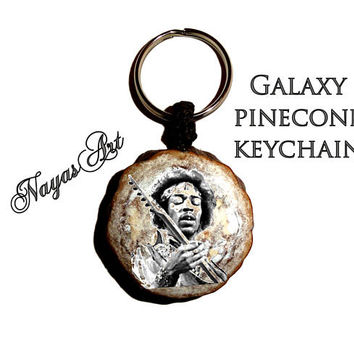 Hendrix keychain, Galaxy pinecone natural keychain keyring. Keychains keyrings accessories, Jimi Hendrix Fender guitar key chain pine cone