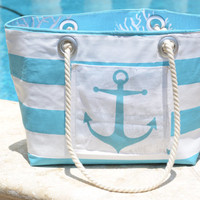 Nautical Beach Bag Tote with turquoise and white stripes, anchor pocket, turquoise coral reef lining, cell phone pocket, soft rope handle