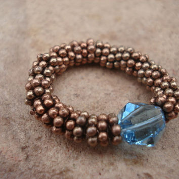 Aquamarine Swarovski Crystal Ring and Antique Copper Daisy Shape Beads, Stretch , For Her