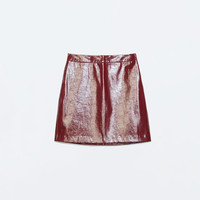 Patent short skirt