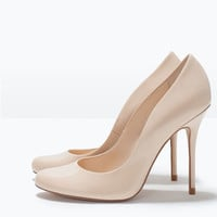 Synthetic patent leather high heel court shoe