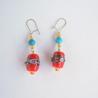 Red, blue and gold dangle earrings.