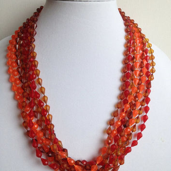 Vintage Amber, Red, and Orange Plastic Faceted Beaded 4 Strand Necklace 50 Inches Long