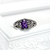 Celtic Knot Ring: Amethyst, Sterling Silver, size 8, 7x5 purple oval,