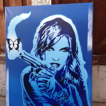 Comic strip woman painting,guns,butterfly,stencil art,spray paints,pop,urban,graphic novel,wall art,blues,white,canvas,smoke,graffiti,street