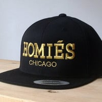 Homies Metallic Gold Snapback Hat with Custom Embroidered Logo.  Made to order quality snap back hats and designs