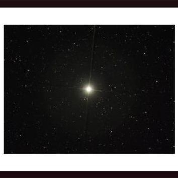 Pollux is an orange giant star in the constellation of Gemini., framed black wood, white matte
