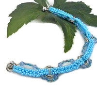 Blue Beaded Bracelet with Mobius Rings
