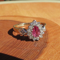 A fine vintage 9k yellow gold, pink tourmaline and diamond ring