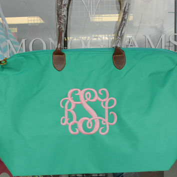 Champ Purse Large Monogram Font Shown  INTERLOCKING