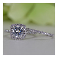 Square Halo Round Brilliant Cubic Zirconia Engagement Ring Set In Sterling Silver