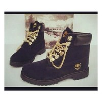 black timberlands with gold chain