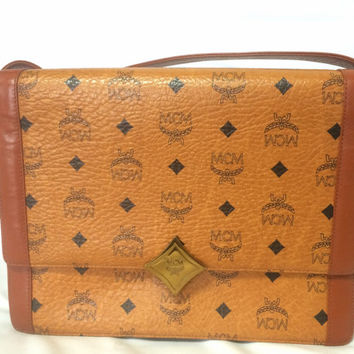 Vintage MCM brown monogram square shoulder bag with leather straps and golden star shape logo motif closure. Designed by Michael Cromer.