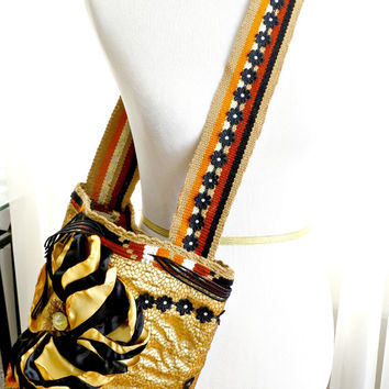 Handmade wayuu mochila bag embellished with lace, silk fabrics and Swarovski crystals.