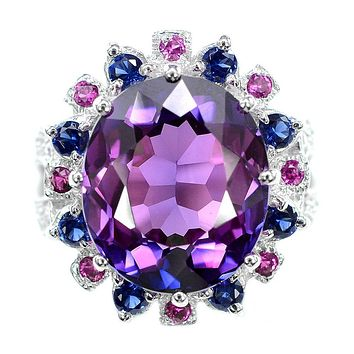 A Vintage 14.9CT Oval Cut Blue Purple Sapphire Ruby & White Sapphire Halo Ring
