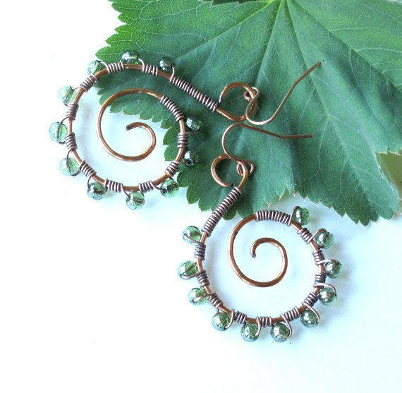 Copper spiral earrings - wire wrapped with vintage green glass beads