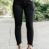 The Lucca Mid Rise Distressed Ankle Skinny