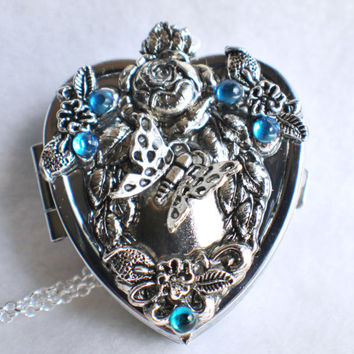 Music box locket,  heart shaped  locket with music box inside, in silver with floral accents, rhinestones and butterfly