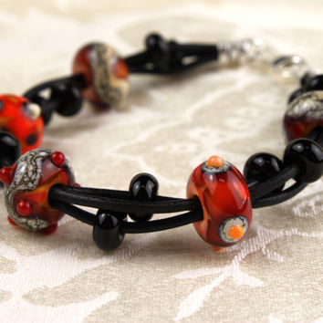 Bracelet - Orange &  Black Glass and Leather Bracelet with Sterling Silver Clasp