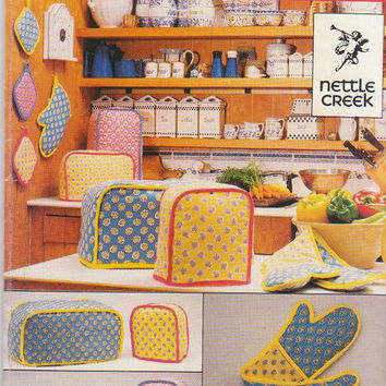 Vintage 1980s pattern for kitchen appliance covers, oven mitt, casserole mitt, and potholder from Nettle Creek for Butterick 4690 UNCUT