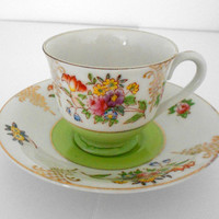 Merit teacup and saucer floral severving ware made in occupied Japan