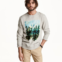 H&M Sweatshirt with Printed Design $29.99