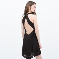 Dress with knotted panels at the back