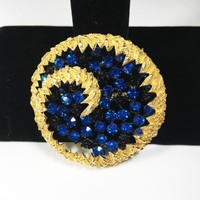 Modernist Gold Tone Circle Brooch with Blue Rhinestones in Open Work Japanned Style Design, Modern Swirl Pin