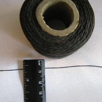 black waxed thread, vintage roll