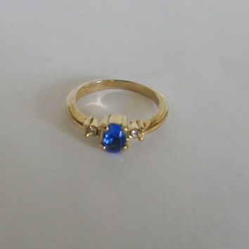 Vintage ring, gold  tone with diamond and sapphire  like stones  size  6