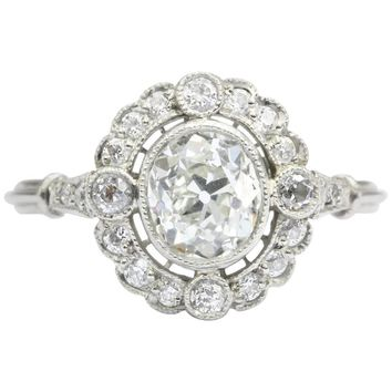 Edwardian Platinum Old Mine Cut Diamond Halo Engagement Ring, circa 1910