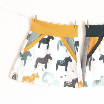Baby or toddler skirt. Yellow waist band. Skirt with dala horses. Sizes 3 Months - 4T. Girl's skirt, small skirt.