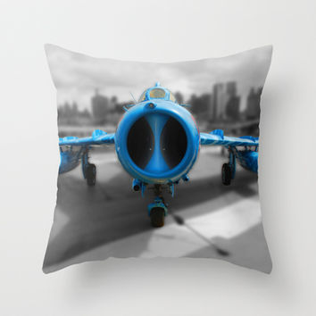 Blue airplane Throw Pillow by Claude Gariepy