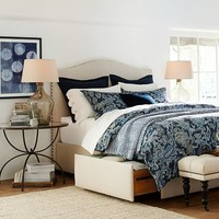 RALEIGH UPHOLSTERED CAMELBACK HEADBOARD & STORAGE PLATFORM BED