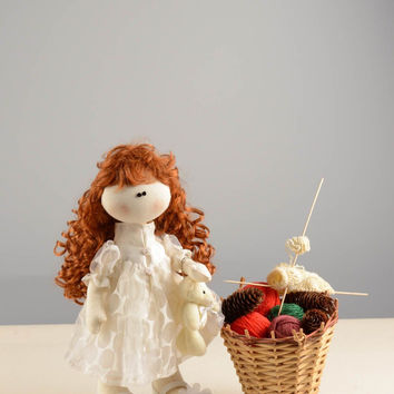 Handmade designer soft doll sewn of linen cute girl with curly hair in dress