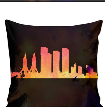 Town silhouette in brown and orange colors, stylish throw pillow design, paint splash