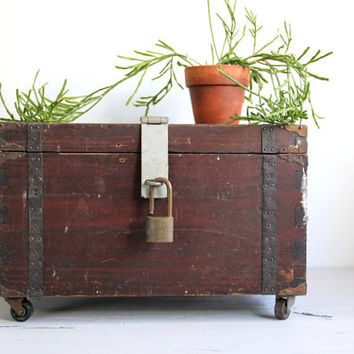 antique box trunk on wheels