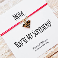 "Silver Superwoman Bracelet with ""Mom...You're My Superhero"" Card 