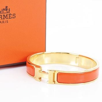 Authentic HERMES Clic Clac H Bracelet Goldtone and Orange Enamel #30896